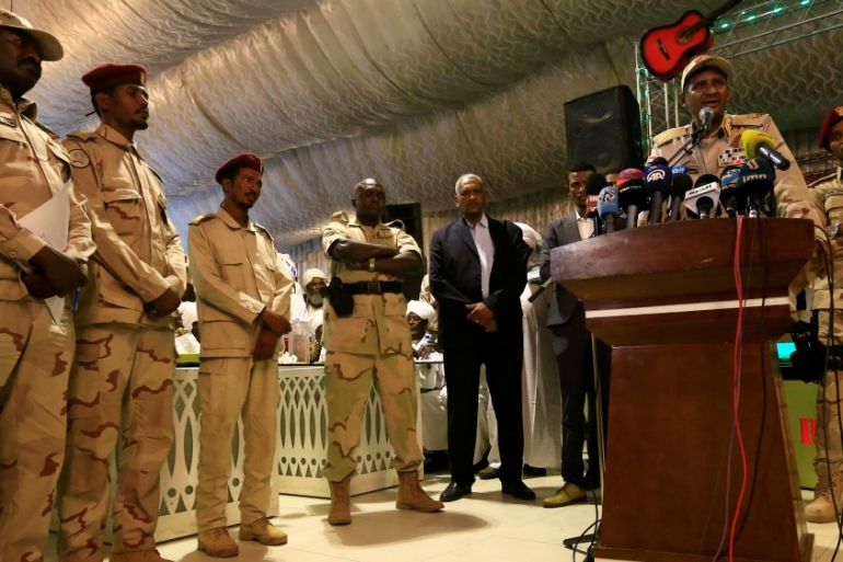 General Mohamed Hamdan Dagalo, (right), is the head of Sudan's Rapid Support Forces [Mohamed Nureldin Abdallah/ Reuters]