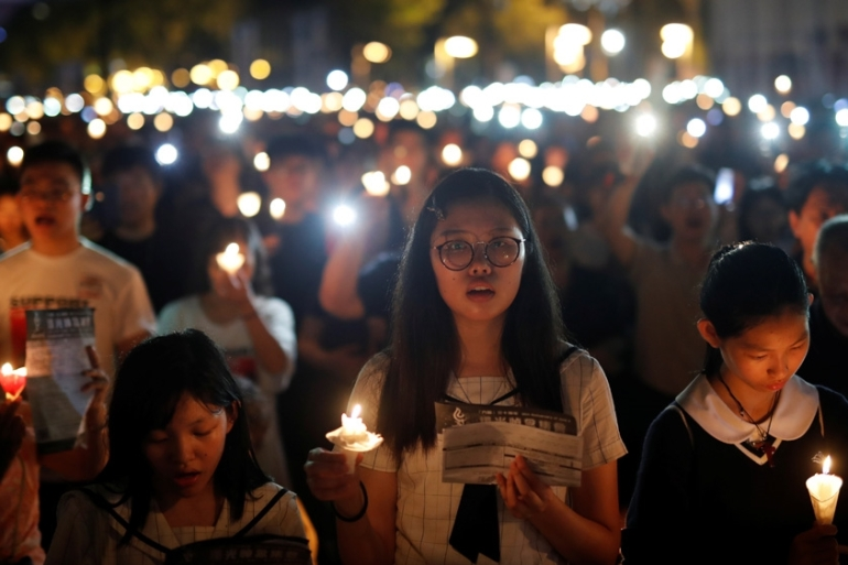 An estimated 180,000 attended the vigil to mark the 30th anniversary of the repression of a pro-democracy movement at Beijing's Tiananmen Square [Tyrone Siu/Reuters]