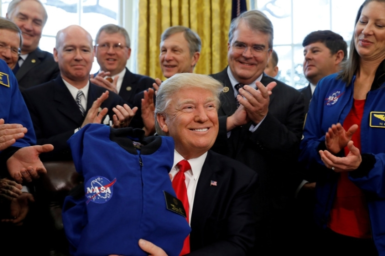 Trump rarely tweets about space or NASA, leaving the agency in the hands of Pence [File:Kevin Lamarque/Reuters]