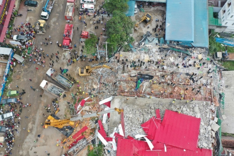 The building collapse that killed 28 construction workers in Sihanoukville on June 22 has raised questions about construction standards and rules [File: Stringer/Reuters]