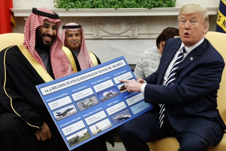 Trump shows a chart highlighting arms sales to Saudi Arabia during a meeting with Saudi Crown Prince Mohammed bin Salman in the Oval Office of the White House, in Washington [File: Evan Vucci/AP Photo]