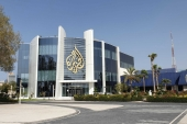 The Al Jazeera Media Network logo is seen on its headquarters building in Doha, Qatar