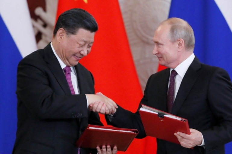 Russian President Vladimir Putin meets his Chinese counterpart Xi Jinping in Moscow [Reuters]