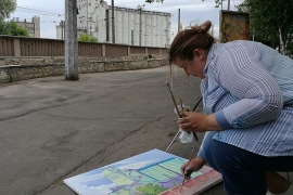 Painter Anna Abramova used to live in Donetsk but was displaced because of the war. In Mariupol, she struggles to make a living as a website designer [Mansur Mirovalev/Al Jazeera]