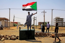 A Sudanese protester demands that the country's Transitional Military Council hand over power to civilians [Reuters]