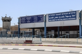 The 'Welcome to Qalandiya' sign is a recent Israeli addition at the Qalandia checkpoint outside occupied East Jerusalem [Jaclynn Ashly/Al Jazeera]