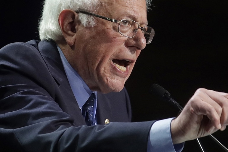 Bernie Sanders has said that the US government should no longer 'subsidise' corporate welfare [Jeff Chiu/AP]