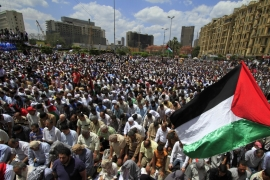Egyptians hold Palestinian flags during Friday prayers at a rally calling for the end of the Israeli occupation on Palestine, in Tahrir square in Cairo on May 13, 2011 [AP/Khalil Hamra]