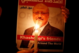 A demonstrator holds a poster with a picture of Saudi journalist Jamal Khashoggi outside the Saudi Arabia consulate in Istanbul [File: Osman Orsal/Reuters]