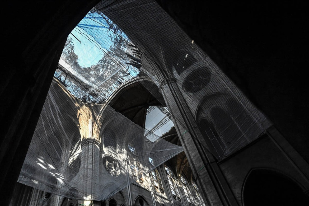 Images of the ancient cathedral going up in flames sparked shock and dismay across the globe, as well as in France, where it is considered one of the nation's most beloved landmarks. [Stephane De Sakutin/Pool/AFP]