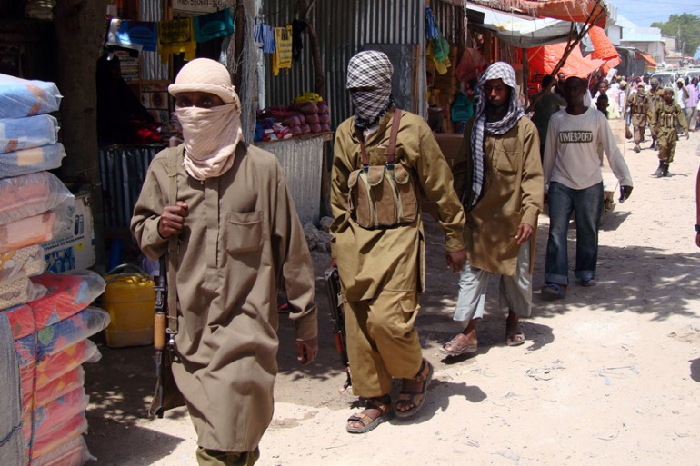 Al-Shabab fighters patrol a market in Mogadishu in 2009 [File: Mohamed Sheikh Nor/AP Photo]