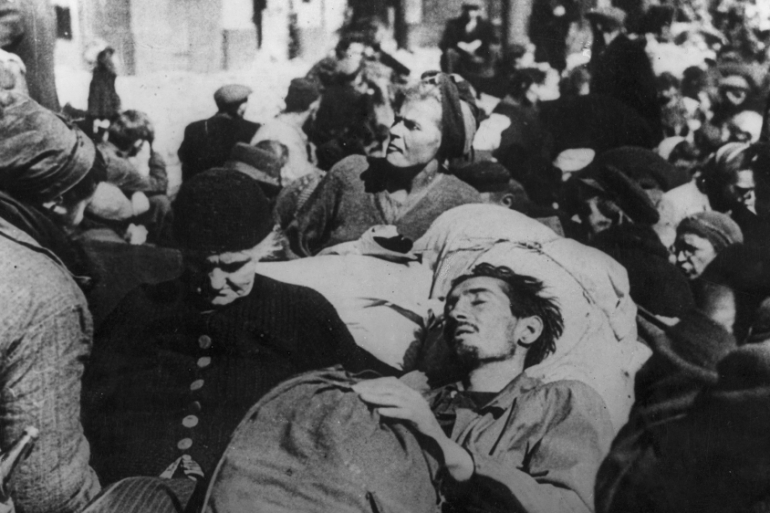 October 1944: Sick and starved people emerge from basements and sewers in Warsaw, two months after the start of the Warsaw Uprising against the occupying German forces [Photo by Keystone/Getty Images]