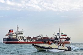 A speedboat of the IRGC circles around a British-flagged oil tanker Stena Impero, which its forces seized on July 19 [File: Hasan Shirvani/Mizan News Agency via AP]