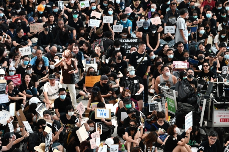 Protesters filled Hong Kong airport's arrivals hall [Anthony Wallace/AFP]