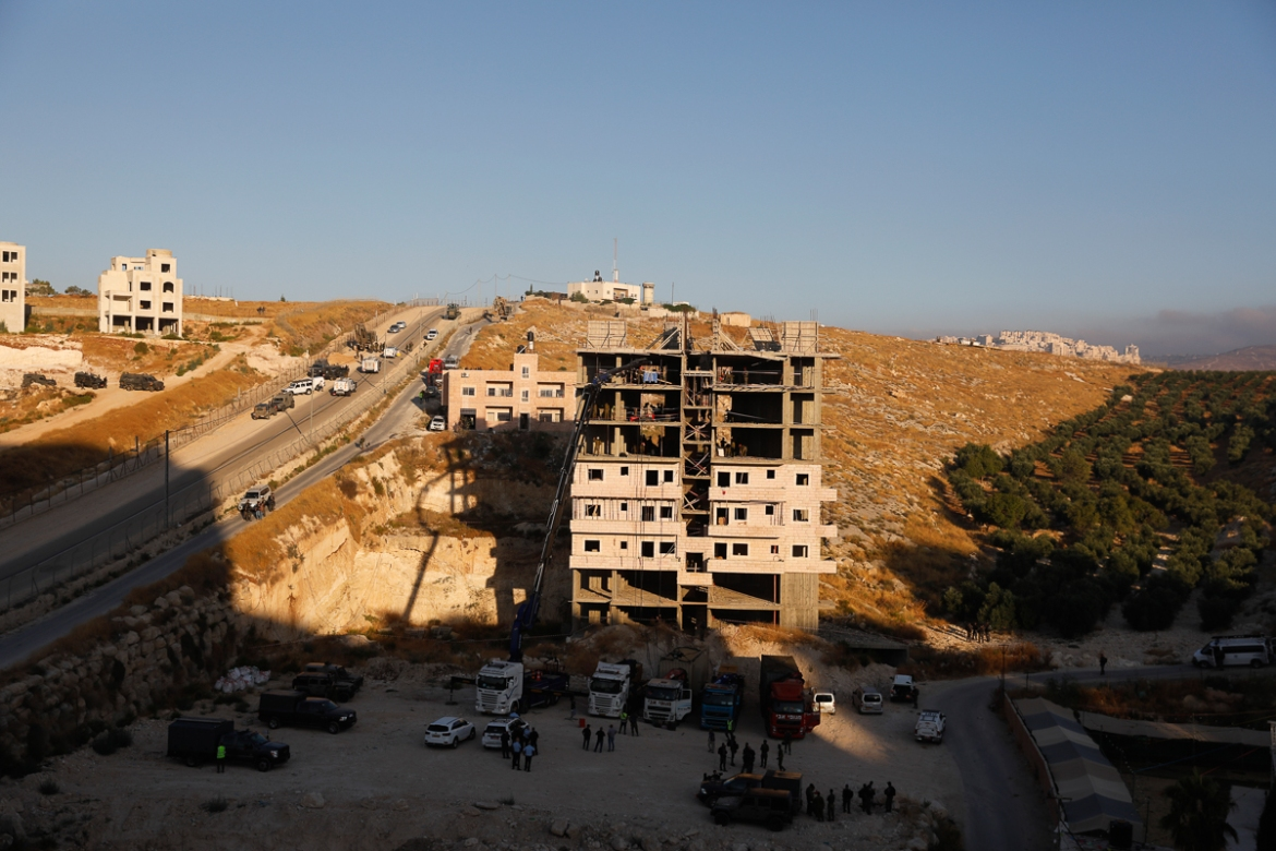 Israeli Internal Security Minister Gilad Erdan said the residents 'are making their own law' by constructing these buildings. [Ahmad Gharabli/AFP]