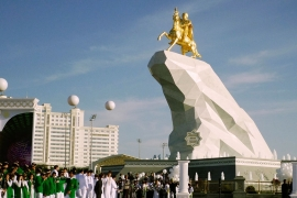 A statue of Turkmen President Gurbanguly Berdymukhamedov atop a mountain of marble is unveiled in May 2015 (AP/ALEXANDER VERSHININ]