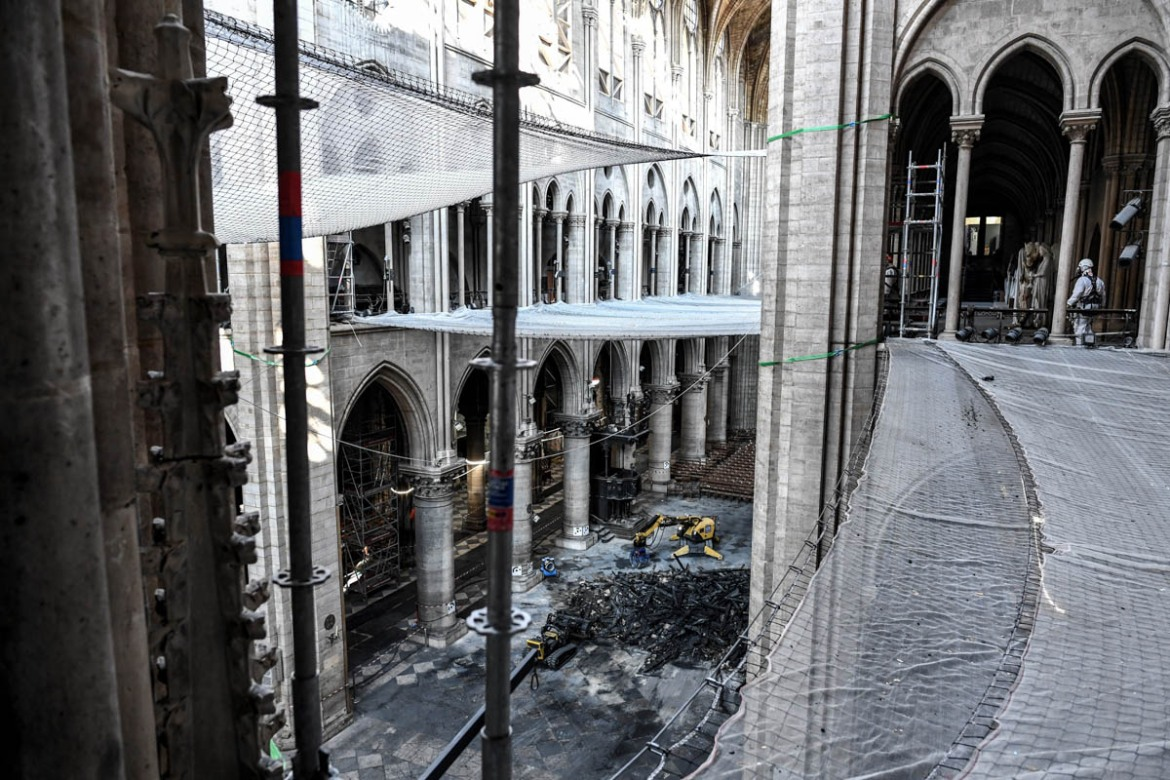 Damage on the nave and rubble as seen during the access granted to journalists on Wednesday. [Stephane De Sakutin/Pool/AFP]