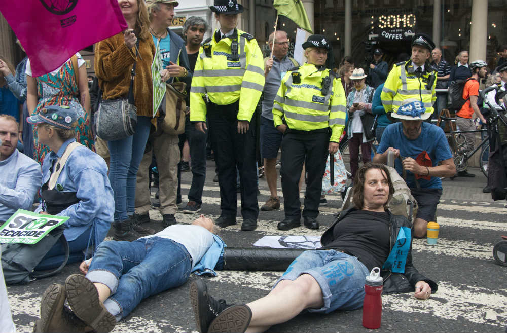 Extinction Rebellion activists hold NUDE protest to expose