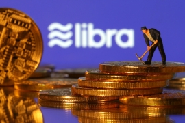 A small toy figure stands on representations of virtual currency in front of the Libra logo in this illustration picture, June 21, 2019. REUTERS/Dado Ruvic/Illustration [Daylife]