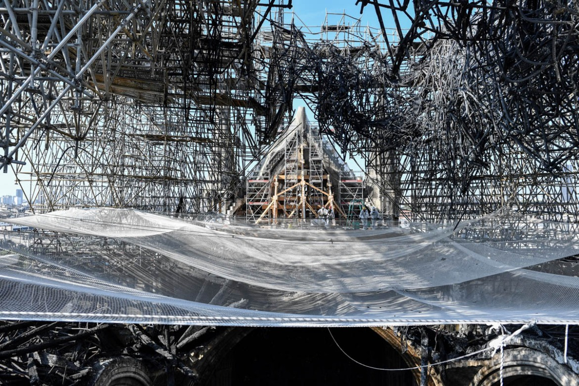 Parts of a destroyed ribbed vault and scaffolding are seen during preliminary work following the inferno on April 15, causes of which are still unknown. [Stephane De Sakutin/Pool/AFP]