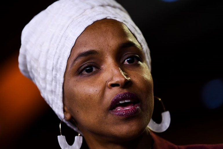 Ilhan Omar speaks during a press conference to address racist tweets by US President Donald Trump [Brendan Smialowski/AFP]