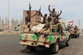 Sudanese soldiers on a military vehicle gesture as they arrive to the port city of Aden, Yemen on November 9, 2015 [File: AP/Wael Qubady]