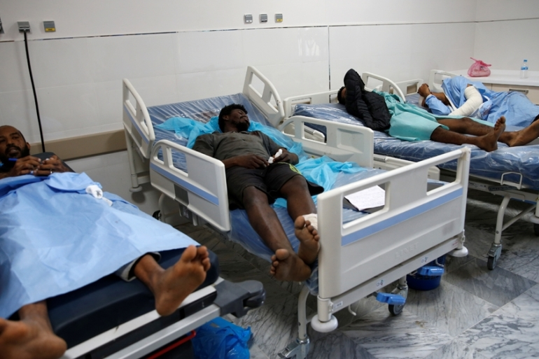 Wounded migrants receive treatment after an air raid hit a detention centre in Tajoura last week [File: Ismail Zitouny/Reuters]
