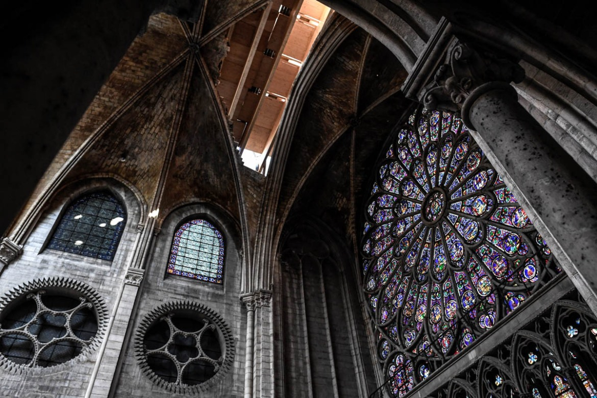 The rosette is seen during preliminary work in the Notre Dame de Paris Cathedral three months after a major fire. [Stephane De Sakutin/Pool/AFP]