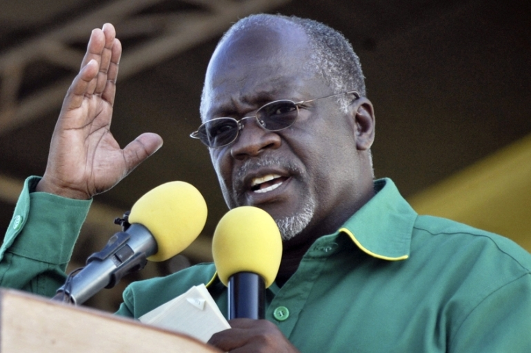 Activists have accused President John Magufuli's government of cracking down on press freedom [File: Khalfan Said/AP)