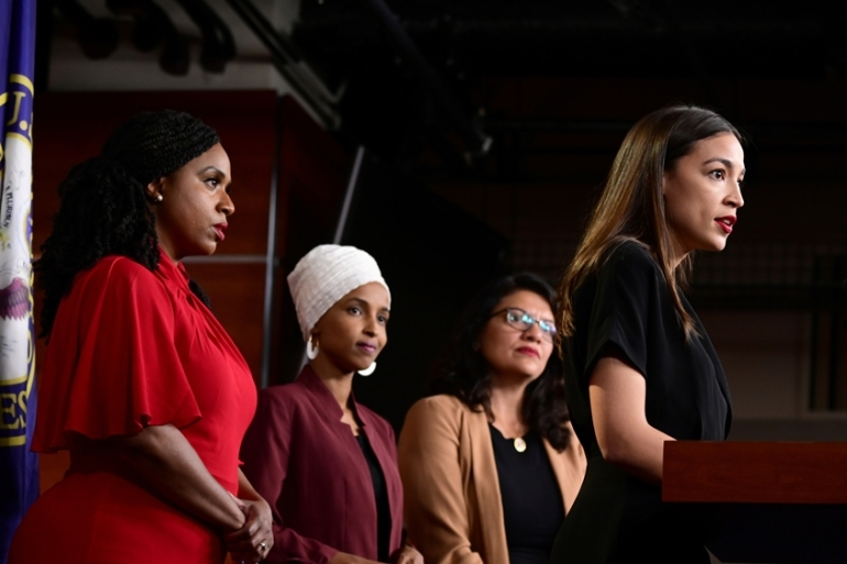 Ayanna Pressley, Ilhan Omar, Rashida Tlaib and Alexandria Ocasio-Cortez hold a news conference after Democrats in the US Congress moved to formally condemn President Trump's attacks on the four minority congresswomen [File: Erin Scott/Reuters]