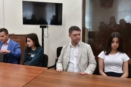 Krestina, Angelina and Maria Khachaturyan are accused of killing their father [Dmitry Lebedev via Reuters]