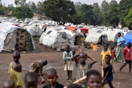 In this file photo from June, Congolese victims of ethnic violence are seen at a makeshift camp for internally displaced people in Bunia, Ituri [File: Olivia Acland/Reuters]