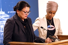Congresswoman Ilhan Omar consoles Congresswoman Rashida Tlaib as they talk about Israel's refusal to allow them to visit the country [Jim Mone/AP Photo]
