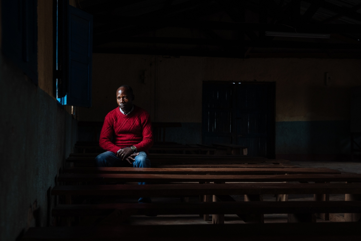 More than 5,000 people attend Saint Emmanuel's Church in Komanda where Pastor Josue, in his weekly sermons, dispels myths that Ebola is a form of black magic. 'If my parishioners want to pray for someone who is infected or died from Ebola, I tell them to do so from a distance. I discourage the notion that only God can protect them. Everyone must take individual responsibility.' [Muse Mohammed/IOM]