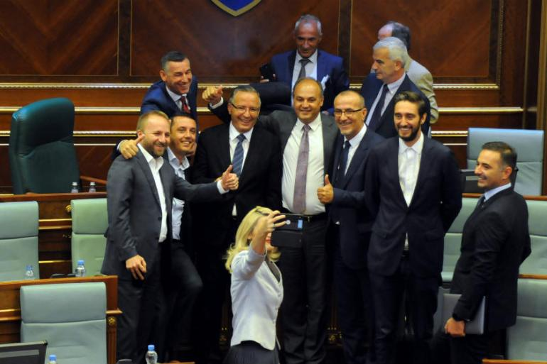 Kosovo politicians take a selfie after voting to dissolve parliament on Thursday [Laura Hasani/Reuters]