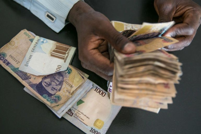 The value of the naira is likely to fall, despite the best efforts of the central bank and government [Jean Chung/Bloomberg]