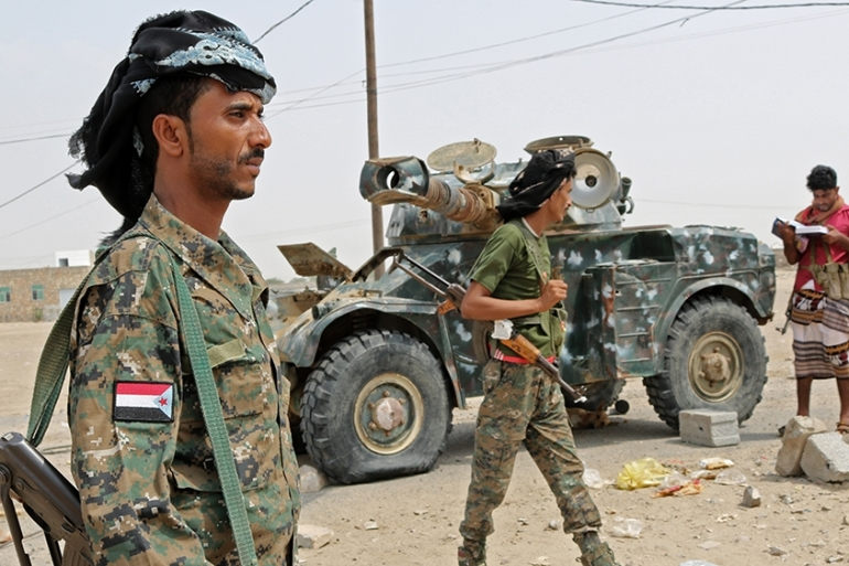The government and the separatist STC, which is backed by the UAE, are the main Yemeni forces in a Saudi-led coalition fighting the Houthi rebels [Nabil Hasan/AFP]