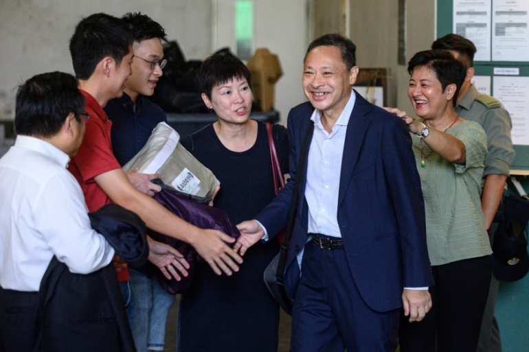 Tai's release on Thursday comes amid protests in Hong Kong [Philip Fong/AFP]