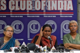 Activist Kavita Krishnan speaks during a news conference to release a report after returning from Kashmir [Anushree Fadnavis/Reuters]