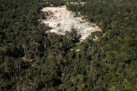 An illegal gold mine, located in a deforested part of the Amazon region, is seen near the city of Castelo dos Sonhos in Para State in Brazil [File:Nacho Doce/Reuters]