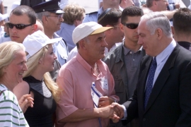 Israeli PM Netanyahu greets Kosovar refugees at Ben-Gurion airport in May 1999; it was his first time to be seen in public since his humiliation at the polls [File: Havakuk Levison/Reuters]