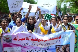 Pakistani students hold placards as they rally in solidarity with Kashmiris in the Pakistani city of Hyderabad [Shakeel Ahmed/Anadolu]
