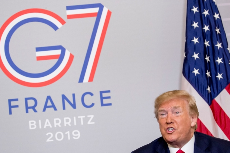 US President Trump told reporters at the G7 meeting he was not surprised that France had invited Zarif [Andrew Harnik/AP Photo]