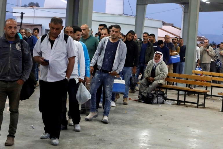 Palestinian workers wait to cross the Israeli-controlled Al-Jalama checkpoint as they head to work in Israel, near Jenin in the Israeli-occupied West Bank May 2, 2019 [File: Raneen Sawafta/Reuters]