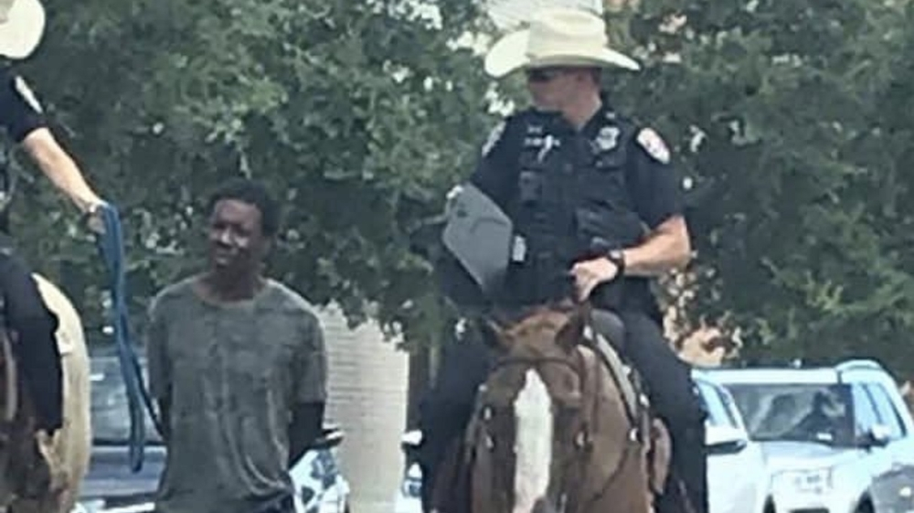 Black man led by rope by white cops on horseback sues Texas city thumbnail