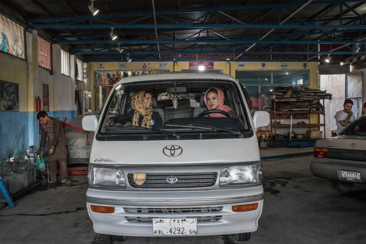 Female drivers say male counterparts or passersby in Kabul often look at them astonished and surprised. [Alessio Mamo/Al Jazeera]