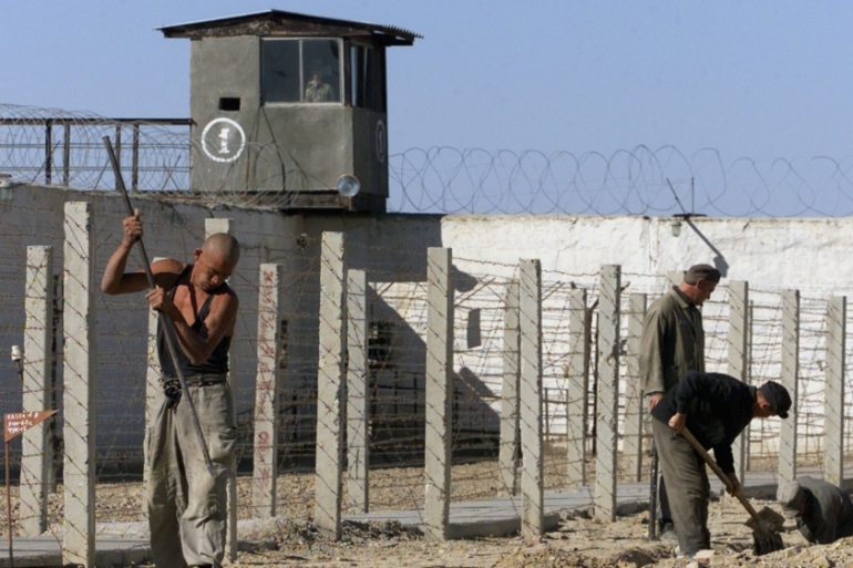 Uzbek convicts toil in the yard of Jaslyk jail in this picture from 2003 [Shamil Zhumatov/Reuters]