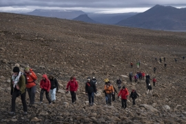 Elected officials, researchers and supporters climbed to the top of what once was the Okjokull glacier to commemorate the first glacier lost to climate change in Iceland [Felipe Dana/AP]