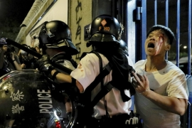 Thousands of Hong Kong civil servants and medical workers are expected to hit the streets on Friday [Vincent Yu/AP]