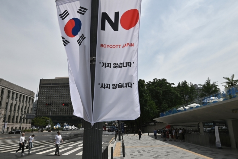 By Tuesday afternoon, some 20,000 South Koreans had signed an online petition against the banners [Jung Yeon-je/AFP]